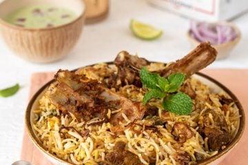 Hot Mutton Biryani served with raita!