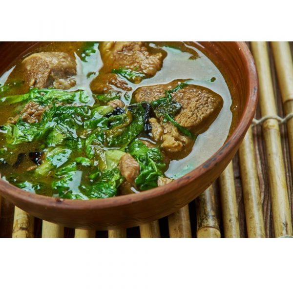 Methi Mutton Curry in a brown earthen bowl