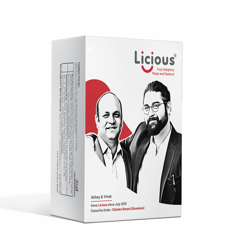 A Licious package on a white background. The box is white with the smiling faces of the Licious founders - Abhay and Vivek on it and the Licious logo in the top right corner.