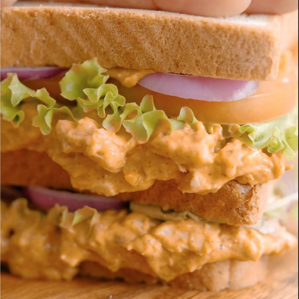 Butter chicken club sandwich made with Licious spreads.